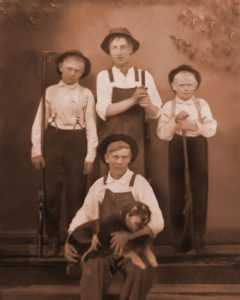L-R: Chris Frederiksen, Frank Carey Jr., Swen Frederiksen Front: Unknown young man with dog