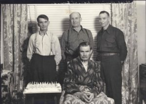 Standing l-r - Oliver W., Fred H. and Jesse D. Daniels Seated - David H. Daniels