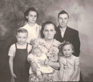 Preussler Family - (l-r) Melvin, Olive, David (baby), Marilyn and Marie, Merton standing (ca. 1944)